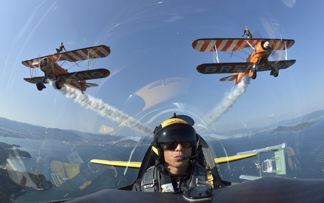 The Breitling Wing Walking team celebrated their first flights in Japan by flying in formation with Japanese Red Bull Air Race Pilot Yoshihide Muroya, flying his Breitling Extra 300L aircraft over the Seto Inland Sea close to Hiroshima, Japan, on Saturday, May 2, 2015. Both Muroya and the British Wing Walking team. (Photo by Katsuhiko Tokunaga/AP Images/Breitling)