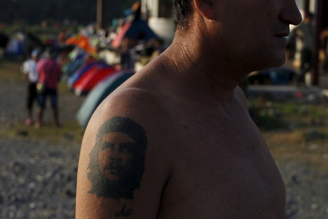 "A Cuban migrant sporting  a tattoo of the late revolutionary hero Ernesto ""Che"" Guevara is pictured at the provisional shelter in Paso Canoas, border with Costa Rica, in Panama, March 21, 2016. (Photo by Carlos Jasso/Reuters)"