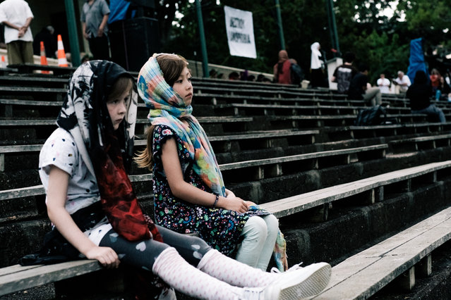 Children attend a vigil for the lives taken in the Christchurch terror attacks at the Auckland Domain on March 22, 2019 in Auckland, New Zealand. 50 people were killed, and dozens were injured in Christchurch on Friday, March 15 when a gunman opened fire at the Al Noor and Linwood mosques. The attack is the worst mass shooting in New Zealand's history. (Photo by Cam McLaren/Getty Images)