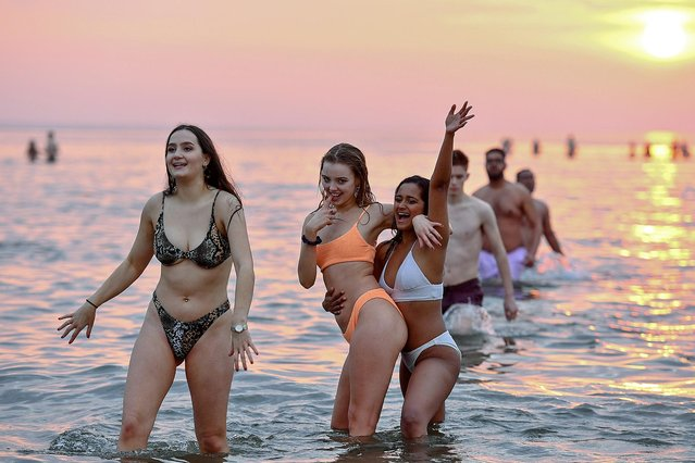 Students from St Andrews University take part in the traditional May Day dip into the North Sea at East Sands beach on May 1, 2019 in St Andrews, Scotland. (Photo by World Entertainment News Network)