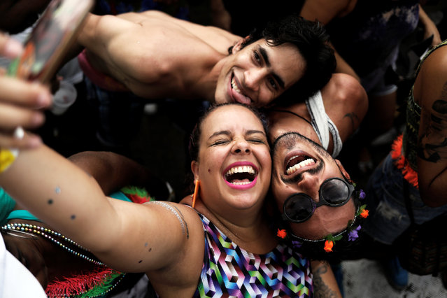 Revellers pose for a selfie as they take part in the annual carnival block at the Latin America Memorial in Sao Paulo, Brazil, February 12, 2017. (Photo by Nacho Doce/Reuters)