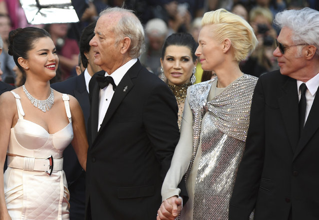 "Actors Selena Gomez, from left, Bill Murray, Tilda Swinton and director Jim Jarmusch pose for photographers upon arrival at the opening ceremony and the premiere of the film ""The Dead Don't Die"" at the 72nd international film festival, Cannes, southern France, Tuesday, May 14, 2019. (Photo by Arthur Mola/Invision/AP Photo)"