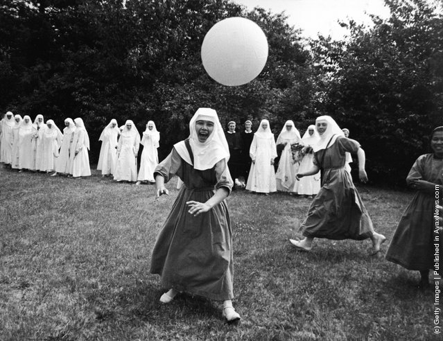 A group of nuns play basketball outdoors at the Ladywell Convent, Godalming, England, 1965