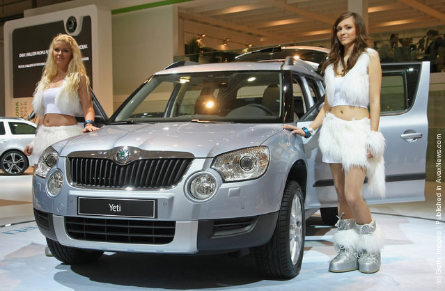 Models present a Yeti compact SUV at the stand of Czech automaker Skoda at the AMI 2009 International Auto Fair