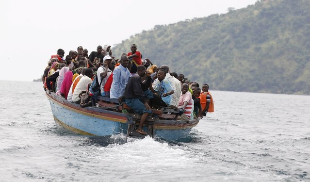 Tanzanians sail on a commercial boat with their belongings on the shores of Lake Tanganyika near Kigoma in western Tanzania, May 18, 2015. (Photo by Thomas Mukoya/Reuters)