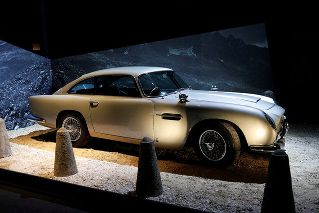 """An Aston Martin DB5 from the James Bond film """"Goldfinger"""" is displayed during a press presentation of the exhibition """"The Designing 007: Fifty Years of Bond Style"""" at the Grande Halle de la Villette in Paris, France, April 13, 2016. (Photo by Benoit Tessier/Reuters)"""