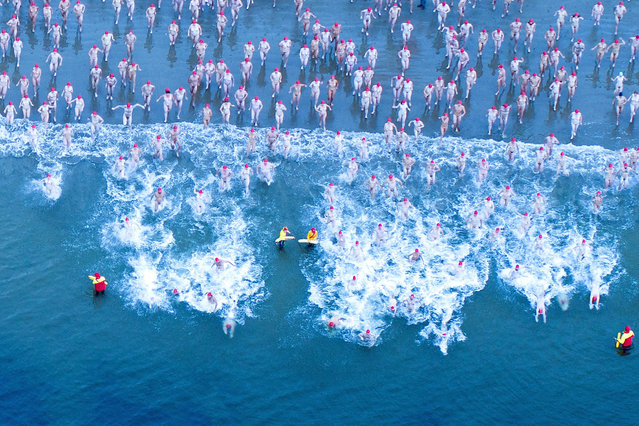 Swimmers participate in the 2019 Dark Mofo Nude Solstice Swim at Sandy Bay beach, Hobart, Australia, 22 June 2019. The Dark MOFO, the winter version of the Museum of Old and New Art: Festival Of Music and Art (MONA MOFA), celebrates the darkness of the Southern Hemisphere Winter solstice on 21 June. (Photo by Rob Blakers/EPA/EFE)