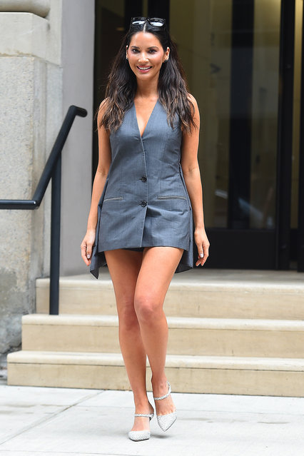 Olivia Munn wears a grey jumper at Buzz Feed in New York City on June 25, 2019. (Photo by Robert O'Neil/Splash News and Pictures)