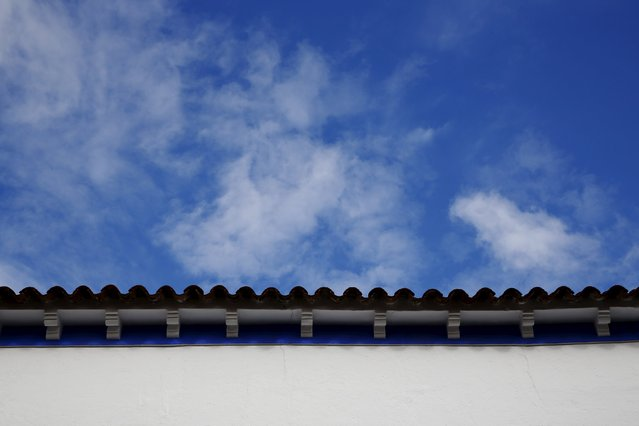 A house painted in the traditional indigo and white Manchegan style is partially seen in Alcazar de San Juan, Spain, April 5, 2016. (Photo by Susana Vera/Reuters)
