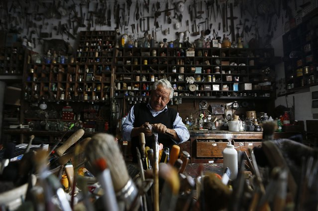 Italian collector Domenico Agostinelli works in his museum in Dragona, near Rome November 4, 2014. Agostinelli has a passion that has led him over the past 60 years to pick up and collect things of all types, from antique art to everyday objects of the past and present. His collection includes a 65-million-year-old dinosaur egg, meteor fragments, a car that once belonged to American mob boss Al Capone, a lock of hair of Italian national hero Giuseppe Garibaldi, toys, weapons, musical instruments of all kinds and many more. (Photo by Tony Gentile/Reuters)