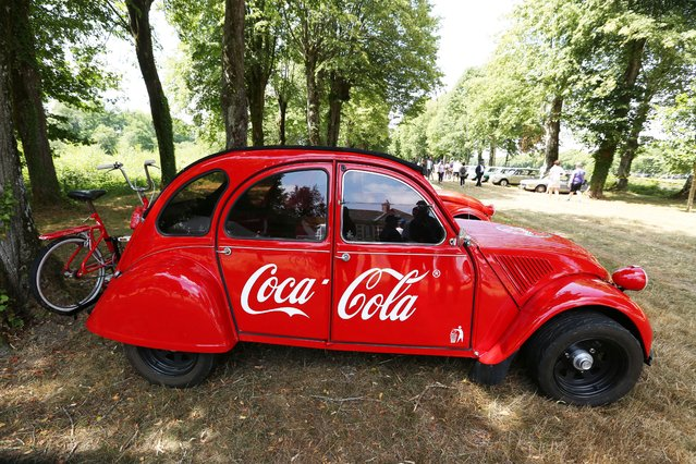 "Very rare Citroen 2CV Coca-Cola with matching mounted bicycle exhibited at ""Rally of the Century"" for the Centenary of Citroen in commune La Ferte-Vidame, France on July 19, 2019. (Photo by Patrick Siccoli/Rex Features/Shutterstock)"