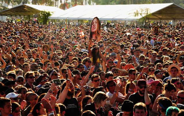 Music fans attend Haim's performance. (Photo by Frazer Harrison/Getty Images for Coachella)