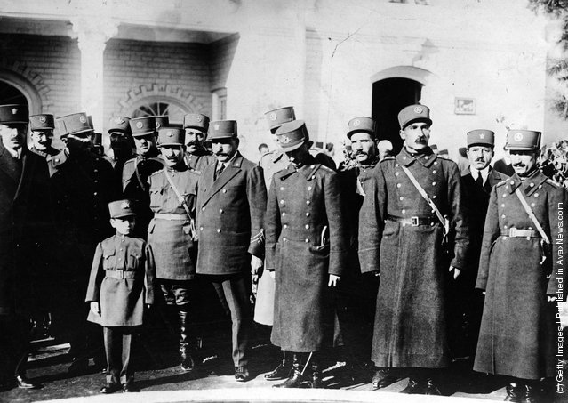 Crown Prince Valiaha of Persia who when older became the Shah of Iran is viewed with a group of officials after he officially opened a new military school in Tehran