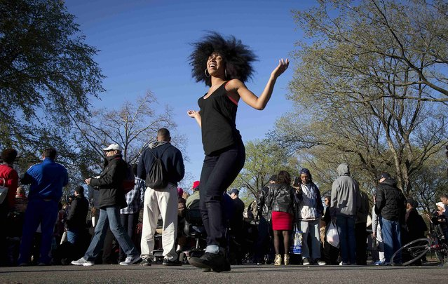 A woman takes part in a 420 dance party, an event celebrating marijuana culture, at Central Park in New York April 20, 2014. (Photo by Carlo Allegri/Reuters)