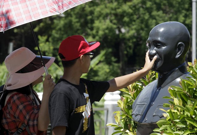 A person touches a statue of the late president and Nationalist leader Chiang Kai-shek in Taoyuan, nothern Taiwan, July 5, 2015. (Photo by Pichi Chuang/Reuters)