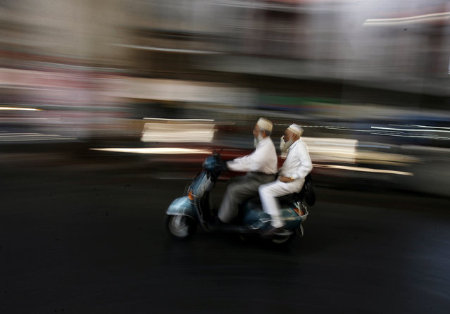 Indian Muslims travel on a scooter in the old quarters of Mumbai December 5, 2008. (Photo by Arko Datta/Reuters)