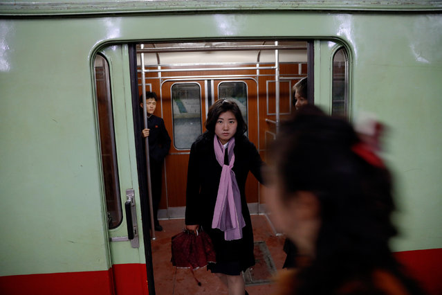 People travel on a train stopping at a subway station visited by foreign reporters, in central Pyongyang, North Korea on April 14, 2017. (Photo by Damir Sagolj/Reuters)