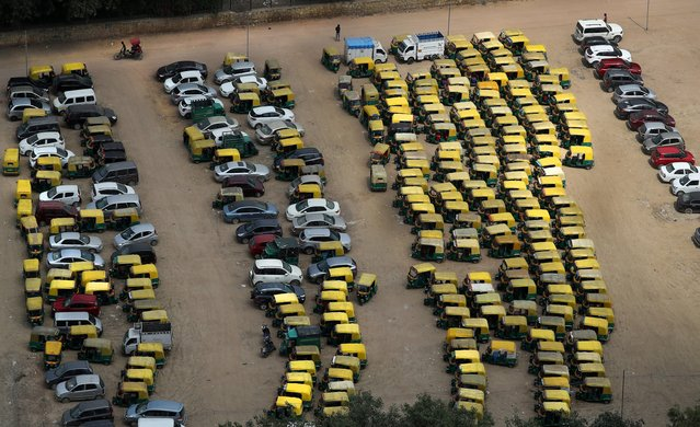 A rickshaw puller pedals past rows of auto-rickshaws and taxis parked during a public transport strike in New Delhi, India, Thursday, September 19, 2019. (Photo by Manish Swarup/AP Photo)