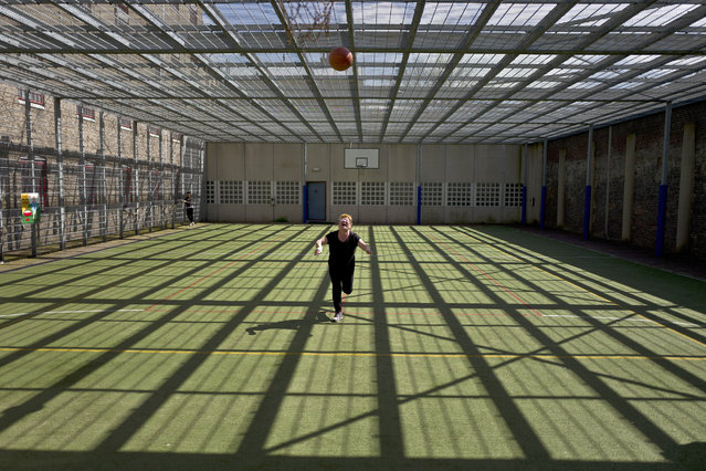 In this Wednesday, April 20, 2016 photo, Mongolian migrant Naaran Baatar, 40, plays basketball at a yard of the former prison of De Koepel in Haarlem, Netherlands. (Photo by Muhammed Muheisen/AP Photo)
