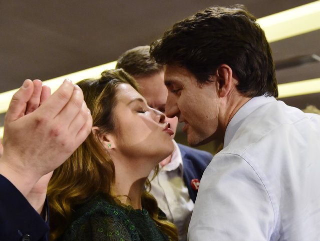 Leader of the Liberal Party of Canada, Justin Trudeau gets a kiss from his wife Sophie Gregoire Trudeau at a rally in Burnaby, British Columbia, on Friday, October 11, 2019. (Photo by Frank Gunn/The Canadian Press via AP Photo)