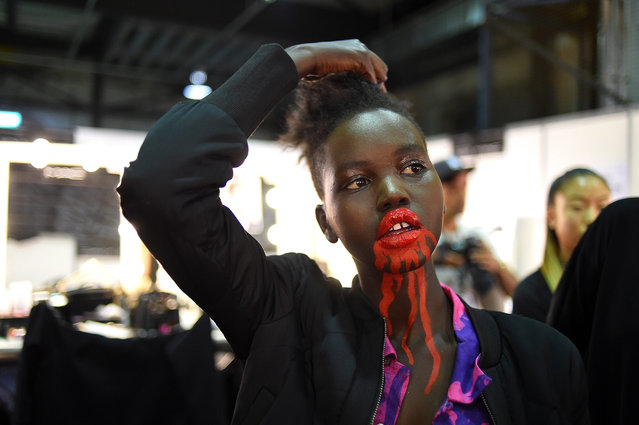 A model is prepared backstage for the show of Australian label Discount Universe during the Mercedes-Benz Fashion Week Australia in Sydney, Australia, 18 May 2016. The show runs from 15 to 20 May. (Photo by Tracey Nearmy/EPA)