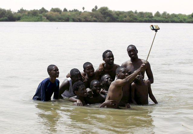A group of young men use a selfie stick to take a picture of themselves in shallow waters known as the first cataract of the River Nile outside Khartoum, Sudan, in this May 22, 2015 file photo. (Photo by Mohamed Nureldin Abdallah/Reuters)