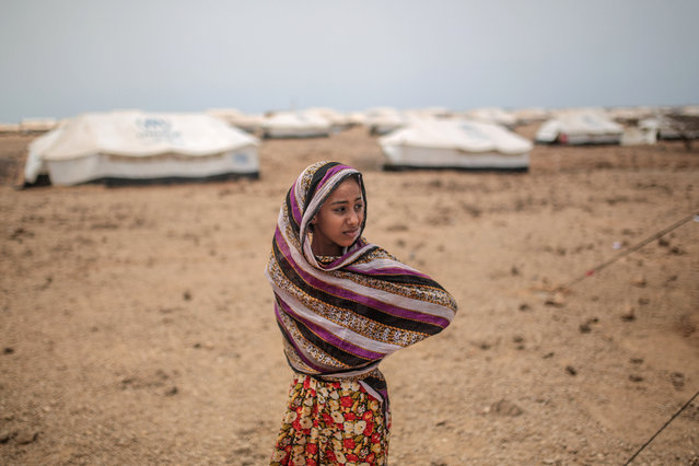 In this Tuesday, May 19, 2015 file photo, Ashwaq, 12, stands outside her family's tent, at the Markaze refugee camp in Obock, northern Djibouti. The Middle East has accounted for more than 50 per cent of the world's population internally displaced by conflict in 2015, with nearly 4.8 million new people forced to flee their homes. A major aid agency says 27.8 million people around the world were internally displaced by conflict and natural disasters last year, or as many as the combined populations of New York City, London, Paris and Cairo. (Photo by Mosa'ab Elshamy/AP Photo/File)