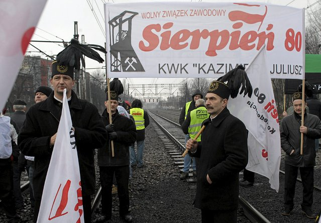 Miners from trade unions block train tracks as they protest against plans to close mines from Kompania Weglowa, in this picture taken January 12, 2015 in Katowice, southern Poland. Poland has persuaded at least three major companies to contribute to a bailout of troubled coal miner Kompania Weglowa, despite some executives' misgivings about the commercial logic of getting involved, sources with knowledge of the matter said. (Photo by Dawid Chalimoniuk/Reuters/Agencja Gazeta)