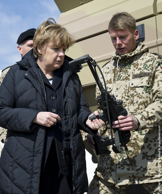 German Chancellor Angela Merkel talks to a soldier during her visit at Camp Marmal in Mazar-i-Sharif, Afghanistan