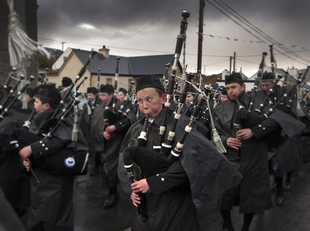 """""""Saint Patricks Day"""". Clew Bay Pipe Band Piper playing at the Achill Island, Ireland Saint Patrick's Day Parade. Photo location: Achill Island, County Mayo, Ireland. (Photo and caption by Glen McClure/National Geographic Photo Contest)"""