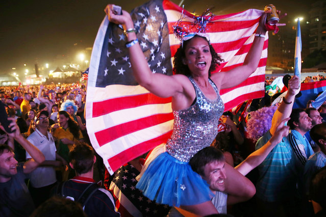 American soccer fans wait for their team to play against Ghana at the FIFA World Cup Fan Fest on Copacabana beach on June 16, 2014 in Rio de Janeiro, Brazil. The teams are playing on the fifth day of the World Cup tournament. (Photo by Joe Raedle/Getty Images)