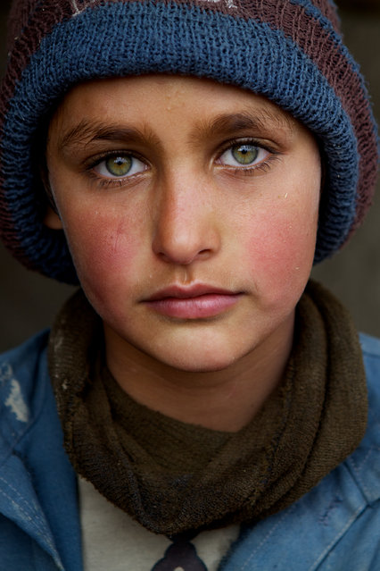 """""""Pashtun refugee boy in Kabul"""". This photo shows a young Pashtun boy in a refugee camp in Kabul. Photo location: Afghanistan. (Photo and caption by Christina Feldt/National Geographic Photo Contest)"""