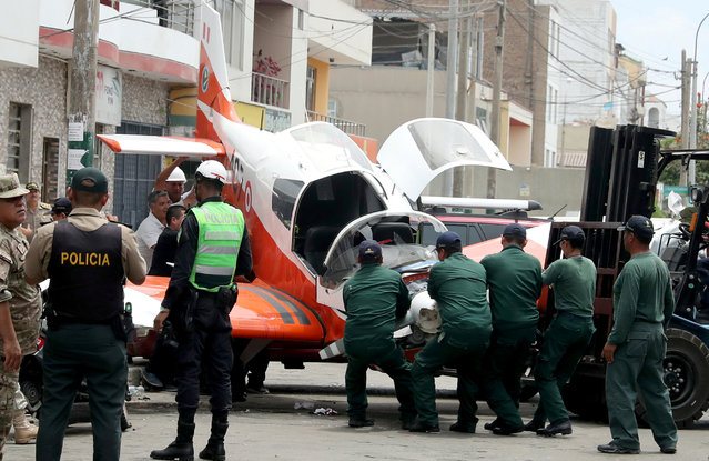 A small Peruvian Air Force plane is seen after it crashed onto a street in Lima, Peru on February 4, 2019. (Photo by Guadalupe Pardo/Reuters)