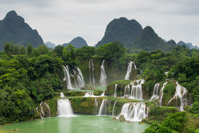 """Ban Gioc Waterfall"". This is the most beautiful waterfall in Northern Vietnamese province of Cao Bang. It is located in the border of Vietnam and China. Haft waterfall on the left photo is of Vietnam, the other side is of China. Photo location: Cao Bang Province, Vietnam. (Photo and caption by Son Tong/National Geographic Photo Contest)"