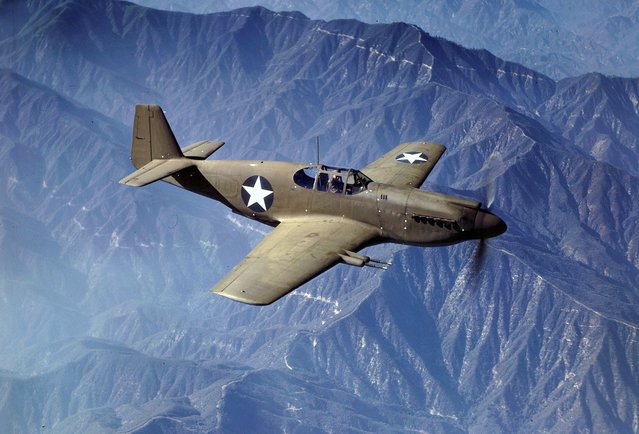 P-51 Mustang fighter in flight, Inglewood, California, The Mustang, built by North American Aviation, Incorporated, is the only American-built fighter used by the Royal Air Force of Great Britain. Photo taken in October, 1942