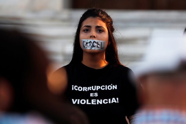A woman protests in front of the Capitol building to demand the resignation of Puerto Rico's governor, Wanda Vazquez, for her management of the distributioin of relief supplies in the aftermath of recent earthquakes, in San Juan, Puerto Rico, 20 January 2020. (Photo by Thais Llorca/EPA/EFE)