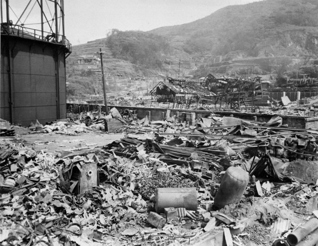 One storage tank is all that remains upright on the site of the Nagasaki gas works.  Drums are scattered amid the debris in the foreground. (Photo by . (Photo by AP Photo)/AP Photo/ACME Pool)