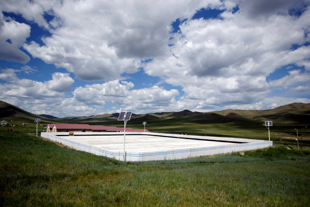 An outdoor training ground is seen among the grasslands at the Mongolia Women's National Wrestling Team training centre in Bayanzurkh district of Ulaanbaatar, Mongolia, July 1, 2016. (Photo by Jason Lee/Reuters)