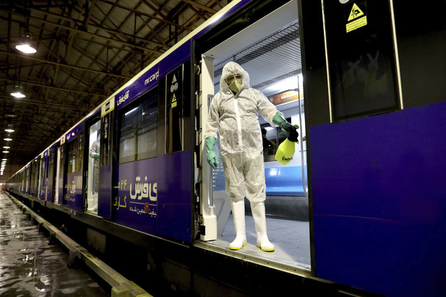 A worker disinfects subway trains against coronavirus in Tehran, Iran, in the early morning of Wednesday, February 26, 2020. Iran's government said Tuesday that more than a dozen people had died nationwide from the new coronavirus, rejecting claims of a much higher death toll of 50 by a lawmaker from the city of Qom that has been at the epicenter of the virus in the country. (Photo by Ebrahim Noroozi/AP Photo)