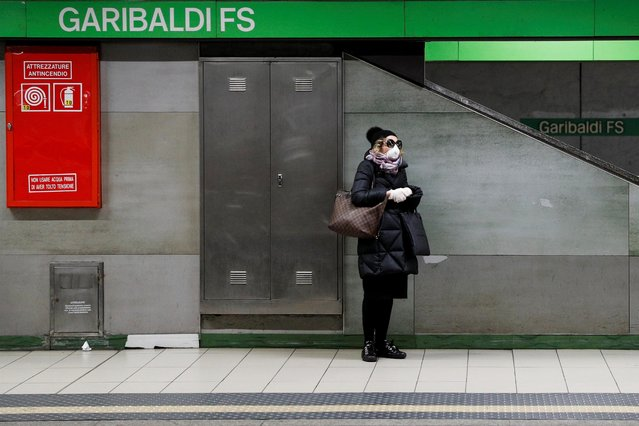 "A woman wearing a protective face mask to prevent contracting the coronavirus waits for a train at the Garibaldi subway station in Milan, March 3, 2020. The government adopted a decree to try to slow infections which have been rising by about 500 per day. The decree orders ""the suspension of events of any nature ... that entail the concentration of people and do not allow for a safety distance of at least one metre (yard) to be respected"". It calls for the closure of cinemas and theatres and tells Italians not to shake hands or hug each other, and to avoid ""direct physical contact with all people"". It also orders all major sporting events, including top flight Serie A soccer matches, to be played in empty stadiums. (Photo by Guglielmo Mangiapane/Reuters)"