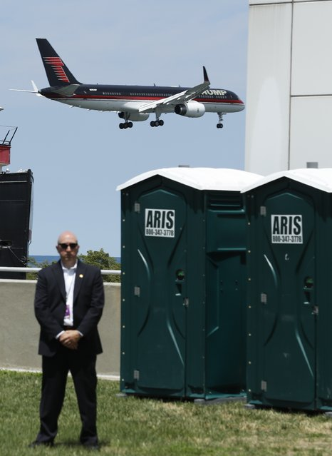 A U.S. Secret Service agent stands watch as a private jet carrying Republican U.S. presidential candidate Donald Trump arrives on the third day of the Republican National Convention in Cleveland, Ohio, U.S., July 20, 2016. (Photo by Jonathan Ernst/Reuters)