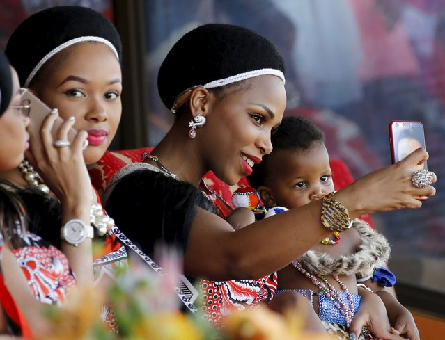 One of King Mswati's 15 wives takes a selfie during the last day of the Reed Dance at Ludzidzini Royal Palace in Swaziland, August 31, 2015. (Photo by Siphiwe Sibeko/Reuters)