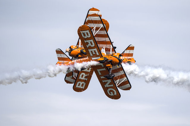 Two biplanes of the Team Breitling cross during a training flight prior the AIR14 air show in Payerne, Switzerland, August 29, 2014. (Photo by Peter Schneider/EPA)