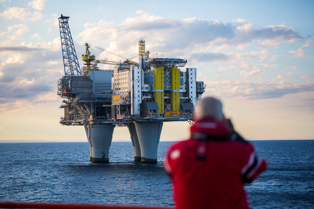 A man looks on oil platform during a cruise in the North Sea, Norway, in this handout picture July 21, 2016. Picture taken July 21, 2016. (Photo by Thomas Mortveit/Reuters/ Edda Accommodation)