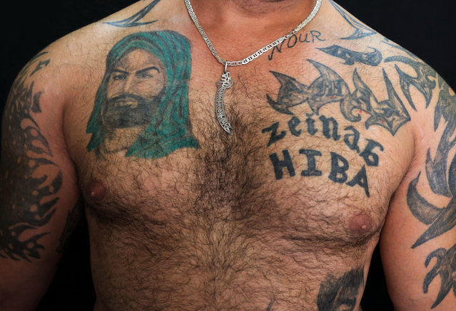 In this Tuesday, July 19, 2016 photo, Zulfiqar, 30, poses for a photo showing his tattoo of Shiite Muslims' first Imam Ali, left, in the southern suburb of Beirut, Lebanon. (Photo by Hassan Ammar/AP Photo)