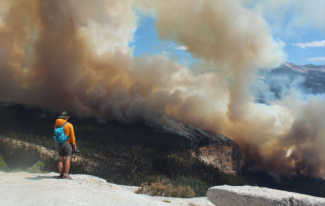 This Sunday, September 7, 2014 photo provided by Rachel Kirk shows smoke from a fire rising above Little Yosemite Valley near Yosemite National Park, Calif. (Photo by Rachel Kirk/AP Photo)