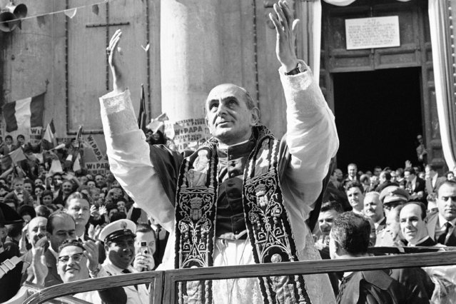 Pope Paul VI raises both arms as he imparts his blessing upon a large crowd gathered in front of the Trinity Church in Genzano, 17 miles south of Rome, after he celebrated Mass and delivered a brief sermon, September 8, 1963. Genzano, located a few miles from the Papal summer residence at Castel Gandolfo, is considered a communist stronghold. The municipal council, including Mayor Giuseppe De Santis, all Communists, attended the Mass. (Photo by Giulio Broglio/AP Photo)