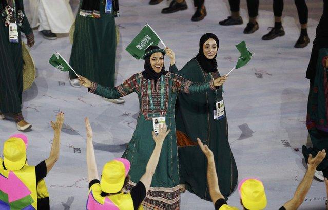 2016 Rio Olympics, Opening ceremony, Maracana, Rio de Janeiro, Brazil on August 5, 2016. Sarah Attar (KSA) of Saudi Arabia waves flags during the opening ceremony. (Photo by Stoyan Nenov/Reuters)