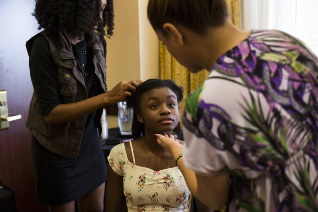 Asya Mercer, 12, of Woodbridge, Va., gets her hair and makeup done before her turn at a photo shoot at a modeling camp at the Courtyard Marriott Hotel in McLean, Va., on Tuesday, August 19th, 2015. (Photo by Brittany Greeson/The Washington Post)