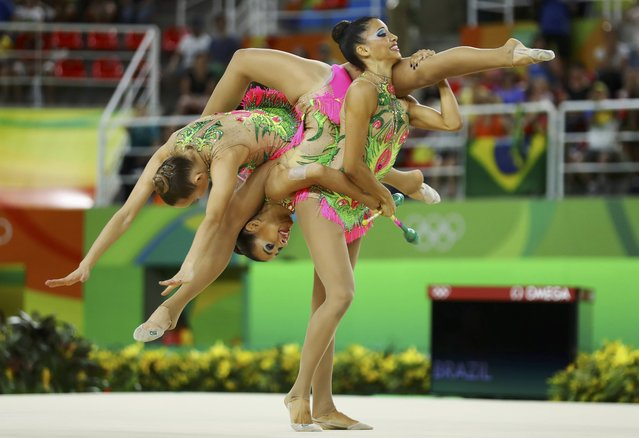 2016 Rio Olympics, Rhythmic Gymnastics, Preliminary, Group All-Around Qualification, Rotation 1, Rio Olympic Arena, Rio de Janeiro, Brazil on August 20, 2016. Team Brazil (BRA) compete using clubs and hoops. (Photo by Mike Blake/Reuters)